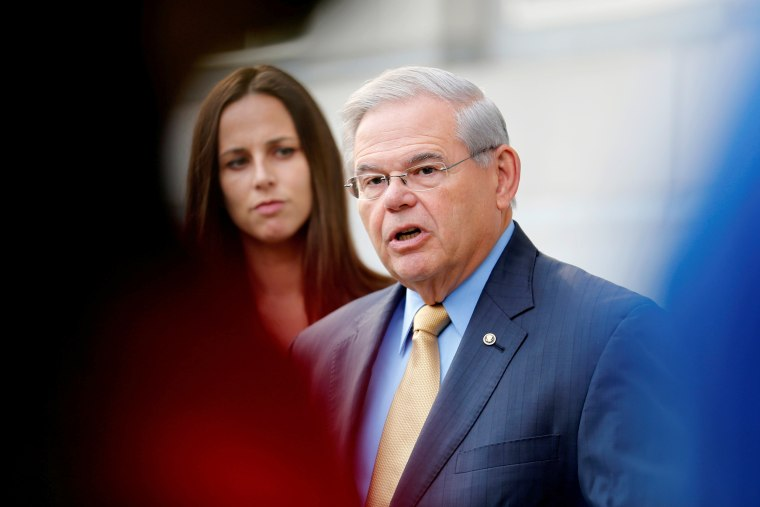 Image: Senator Bob Menendez speaks to journalists after arriving to face trial for federal corruption charges as his daughter Alicia Menendez looks on outside United States District Court for the District of New Jersey in Newark, Sept. 6, 2017.