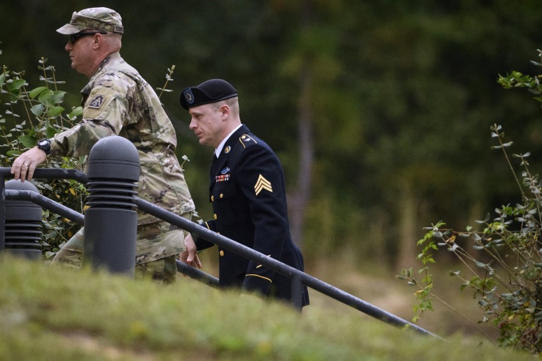 Image: Sgt. Bowe Bergdahl, right, arrives for a motions hearing