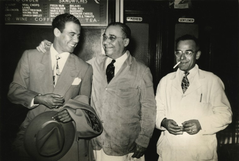 Legendary Puerto Rican songwriter Bobby Capo (on left) next to Andres Sanchez, Galician owner of Central Bar and Grill on 110th and 5th Avenue.