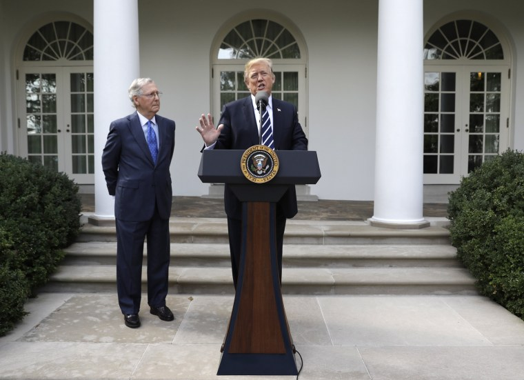 Image: President Donald Trump speaks as Senate Majority Leader Mitch McConnell, R-Ky., listens in the Rose Garden at the White House, Oct. 16, 2017, in Washington.