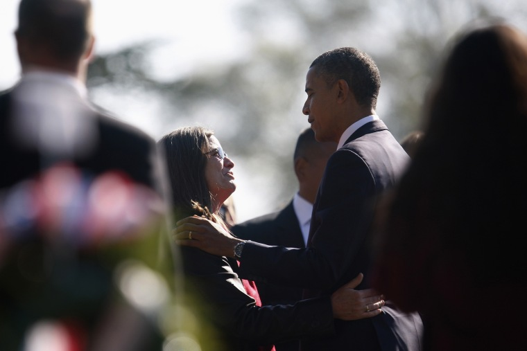 Image: President Barack Obama greets  grieving family members in Section 60 during Veterans Day observances at Arlington National Cemetery in Arlington, Virginia, Nov. 11, 2012.