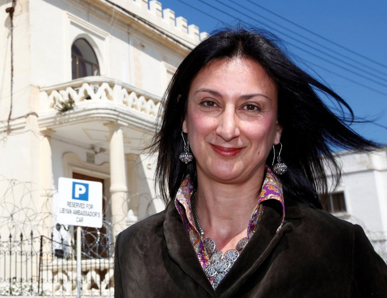 Image: Maltese investigative journalist Daphne Caruana Galizia poses outside the Libyan Embassy in Valletta