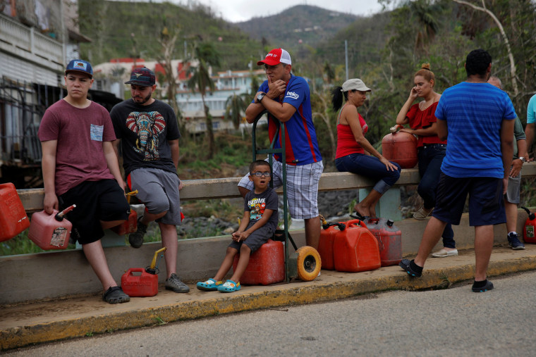 Image: Residents affected by Hurricane Maria wait in line for fuel donated by the Fuel Relief Fund in the municipality of Orocovis, outside San Juan
