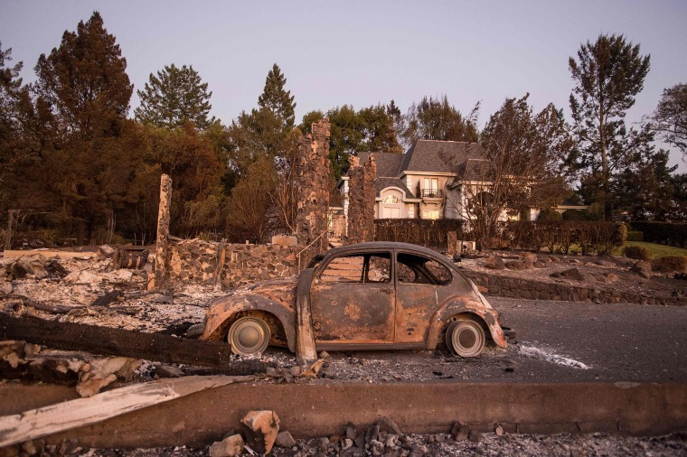 Image: California residents return home to inspect destroyed homes and try to find remaining possessions