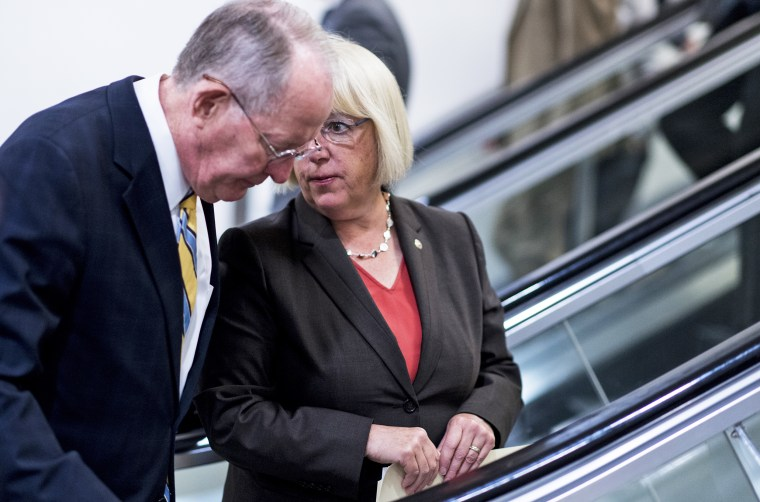 Image: Sen. Lamar Alexander, R-Tenn., speaks with Sen. Patty Murray, D-Wash.
