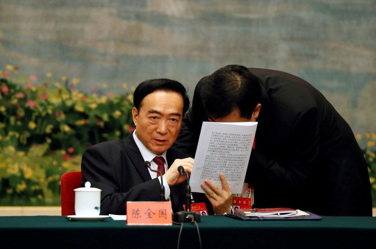 Image: Xinjiang Uyghur Autonomous Region (XUAR) Party Secretary Chen Quanguo, attends a group discussion session on the second day of the 19th National Congress of the Communist Party of China at the Great Hall of the People in Beijing
