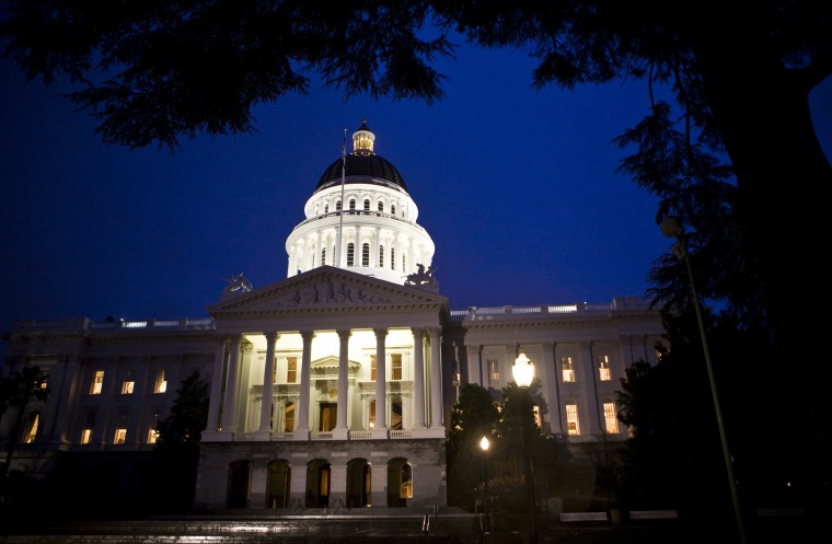 Image: Exterior shot of State Capitol is seen as California legislators work late into the night to pass $40 billion budget in building in Sacramento
