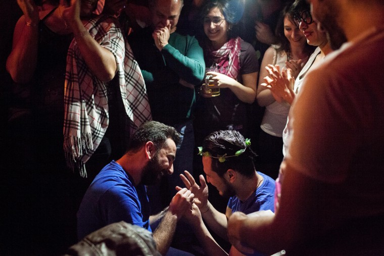 Image: Nader, left, puts a ring on Omar's finger after proposing during Omar's birthday party in Istanbul