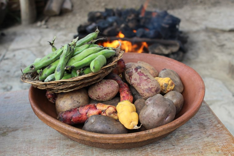 Green beans, potatoes and other tubers ready to be cooked in the 'pachamanca' tradition.