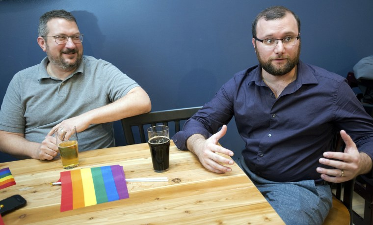 In this Monday, Oct. 16, 2017 photo, David Klennert, left, and Cody Bauer, two of the organizers of OC Pride, discuss the significance of hosting the pride festival during an interview in Orange City, Iowa.