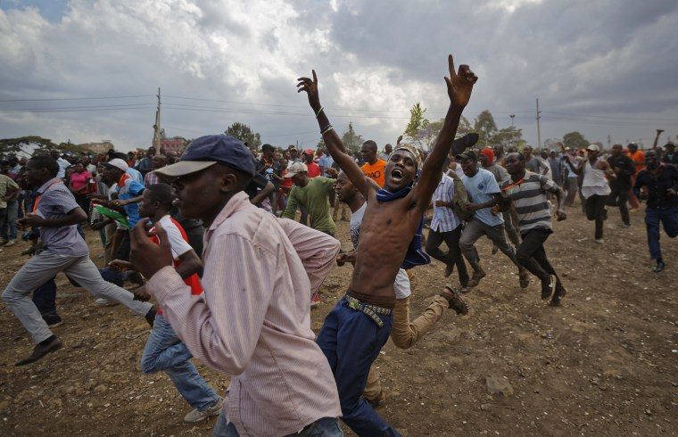 Image: Supporters of Kenyan opposition leader Raila Odinga run through the crowd