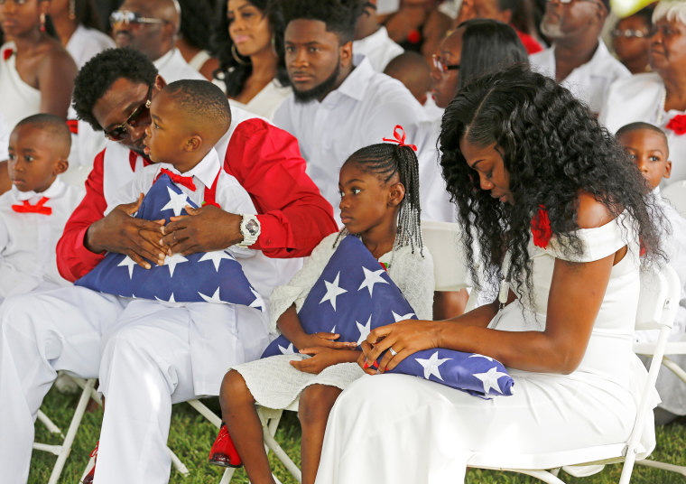 Image: Myeshia Johnson, widow of U.S. Army Sergeant La David Johnson, who was among four special forces soldiers killed in Niger, sits with her daughter, Ah'Leeysa Johnson and son Le David Johnson Jr. at a graveside service in Hollywood