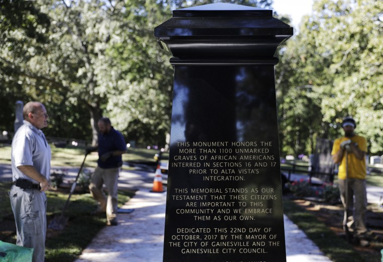 Image: An inscription decorates a monument to honor African-Americans who were buried in unmarked graves