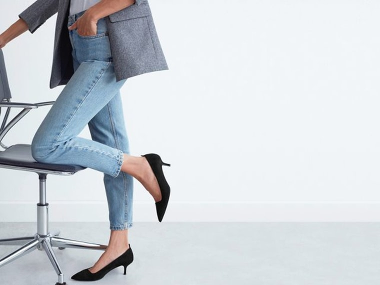 Woman in jeans wearing black heels