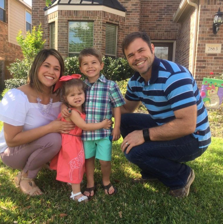 AJ Rodrigue outside her home in a Houston suburb with her husband, BJ, and children Jace, 4, and Jordan, 2.