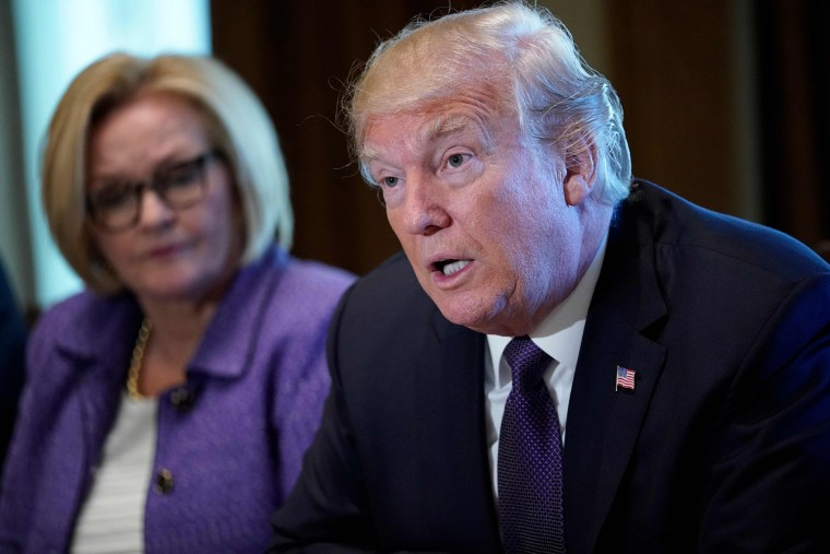 Image: US President Donald Trump speaks next to Senator Claire McCaskill
