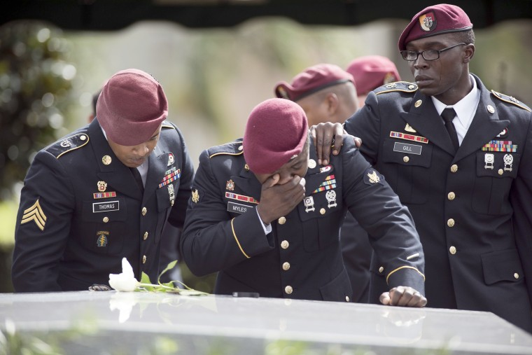 Members of the 3rd Special Forces Group, 2nd battalion, cry at the burial of Army Sgt. La David Johnson on Oct. 21.