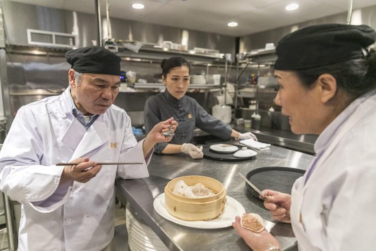 Image: Chen Lieh Tang tastes a xiao long bao at Hwa Yuan