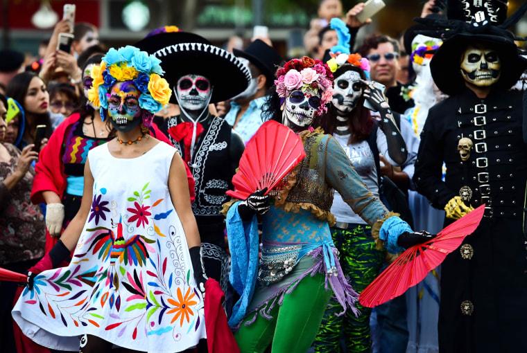 Image: Revelers dance along Reforma Avenue.