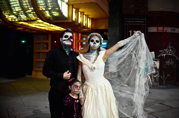 Image: A family poses in costume.