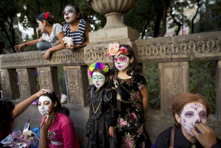 Image: People have their faces painted in preparation for the march.