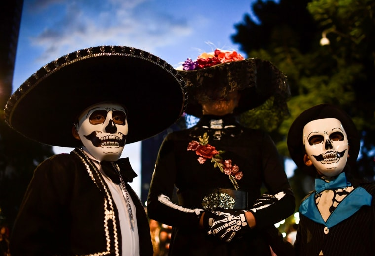 Image: People celebrate in preparation for the Day of the Dead.