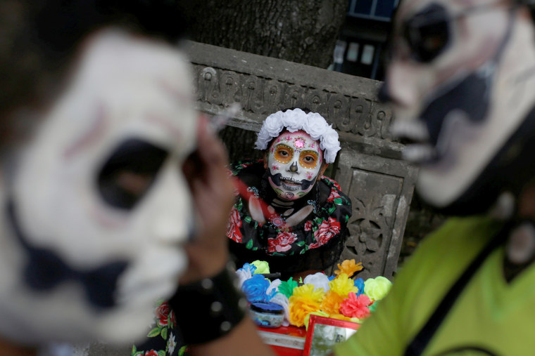 "Image: A woman dressed up as ""Catrina,"" a Mexican character also known as ""The Elegant Death,"" takes part in the Grand Procession of the Catrinas, part of upcoming Day of the Dead celebrations in Mexico City on Oct. 22, 2017."