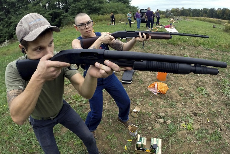 Jon Falstaff, left, shows Emily Lynch how to properly stand and hold a shotgun during an Oct. 8 training session for the Trigger Warning Queer & Trans Gun Club in Victor, N.Y.