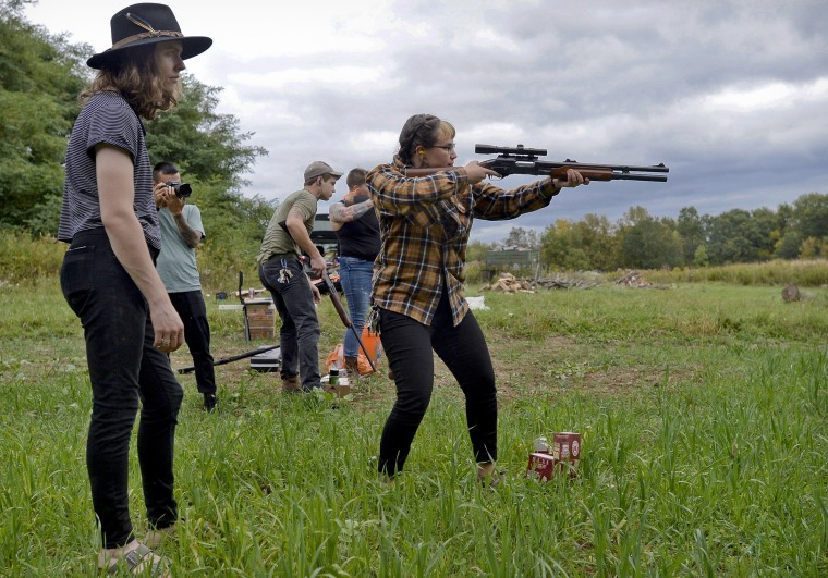 Zora Gussow, center, aims a shotgun during an Oct. 8 training session of the Trigger Warning Queer & Trans Gun Club in a field in Victor, N.Y.