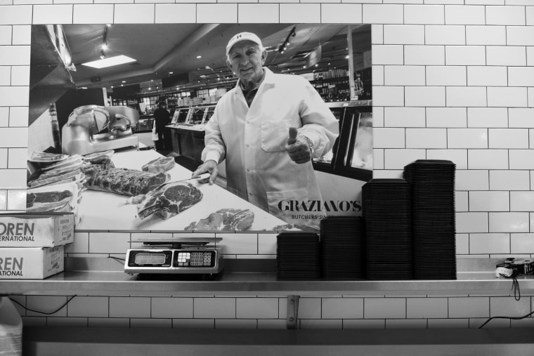 "Mario Graziano in the butcher stall and market he started in Miami, now a successful culinary ""empire"" run by three generations."