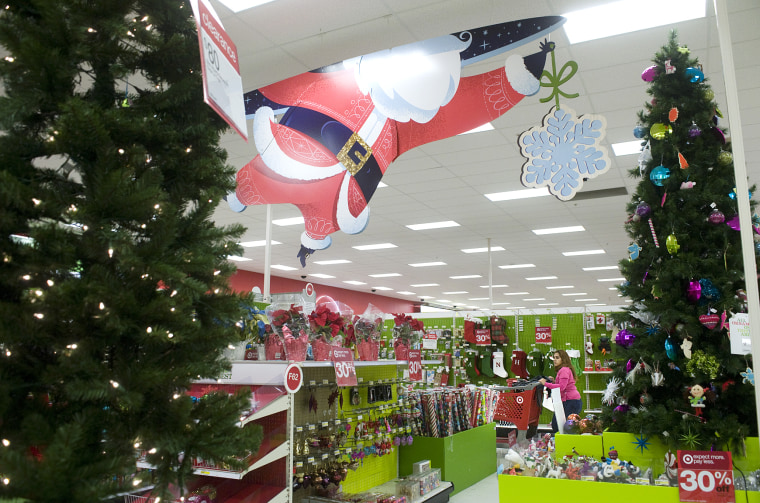 image customers shop in the christmas section of a target - When Can I Put Up Christmas Decorations
