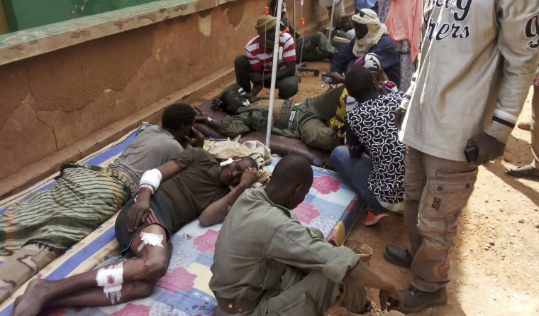 Wounded Malian troops receive medical treatment after a suicide bombing at a base in Gao, Mali, on Jan. 18, 2017.