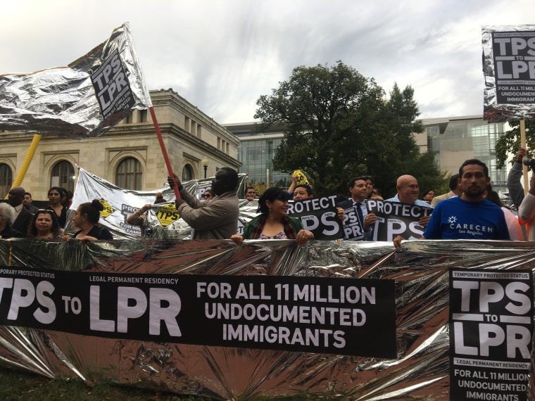 Dozens of Temporary Protected Status (TPS) holders gather outside Department of Homeland Security office to demand an extension for TPS. The groups is comprised of delegates from 21 different organizations from across that country.