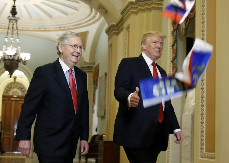 Image: U.S. President Trump walks with McConnell as he arrives for Senate Republican Policy Committee's weekly policy luncheon meeting on Capitol Hill in Washington
