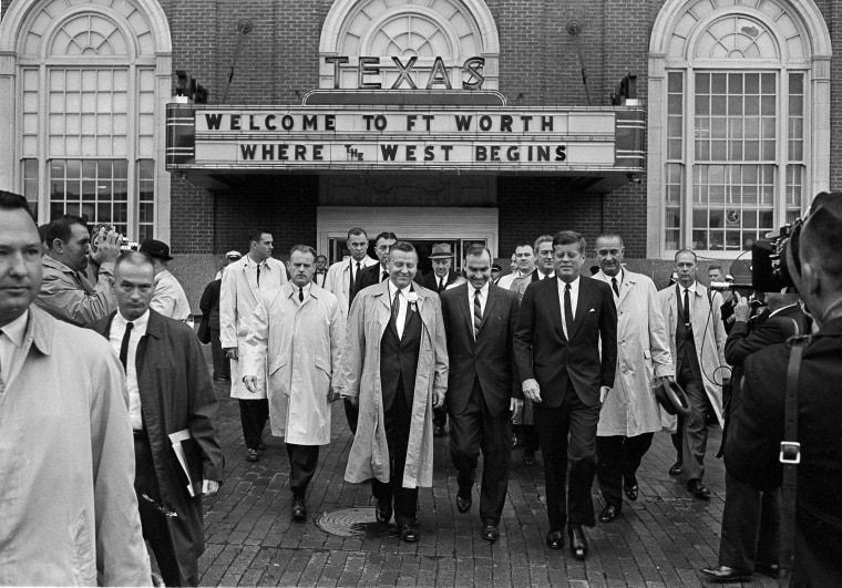 Image: President John F. Kennedy, front, right, exits the Hotel Texas in Fort Worth
