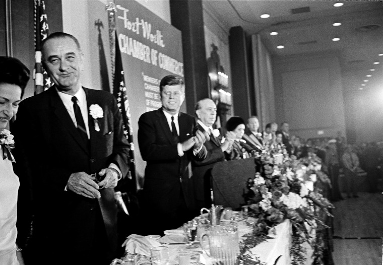 Image: President John F. Kennedy applauds Vice President Lyndon B. Johnson at the Fort Worth, Texas Chamber of Commerce breakfast