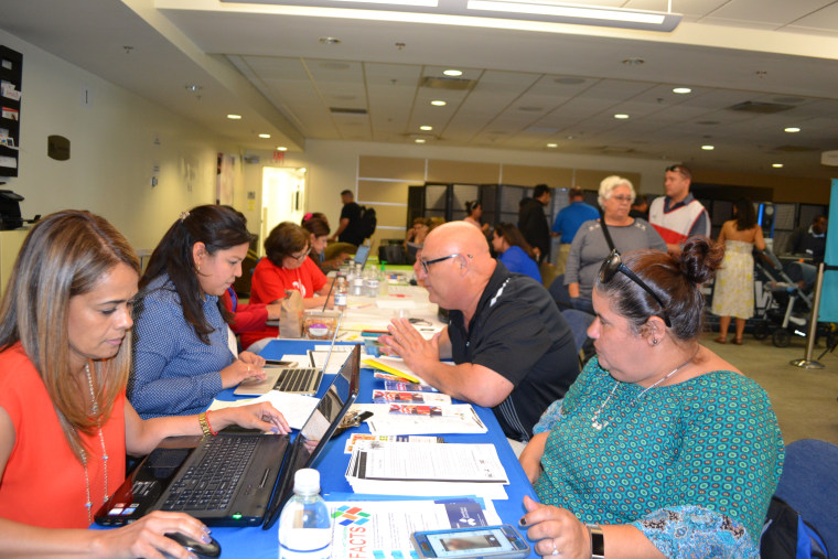 Puerto Ricans seek assistance at the hurricane relief center in Miami International Airport on October 20, 2017.
