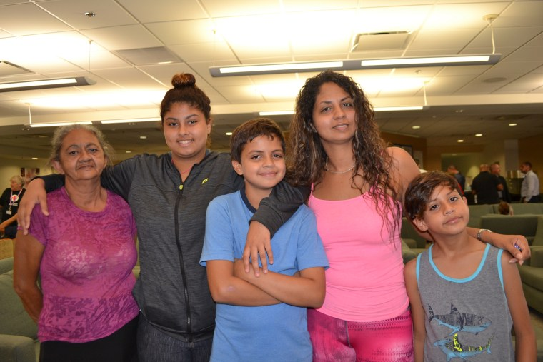 Melissa Nogueras with her mother and three children at the hurricane relief center at Miami International Airport on October, 20, 2017.