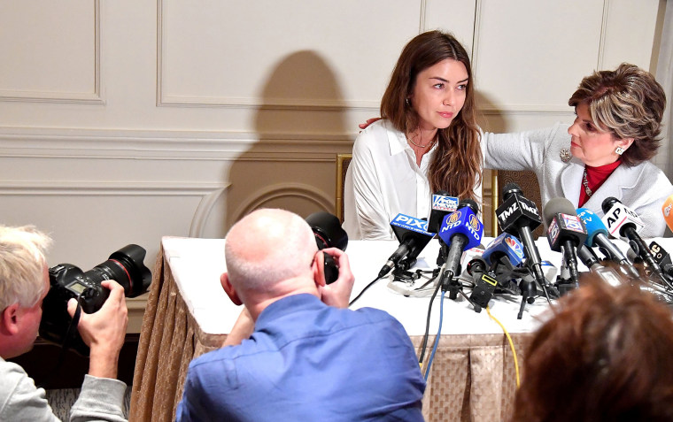 Image: Mimi Haleyi, left, appears at a news conference with her attorney Gloria Allred