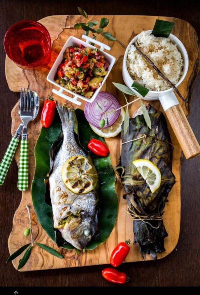 "Inihaw na Isda: grilled banana leaf-wrapped fish, eggplant salad with toasted pancetta, and vanilla rice with toasted sesame seeds from the upcoming ""Migrant Filipino Kitchen"" cookbook."