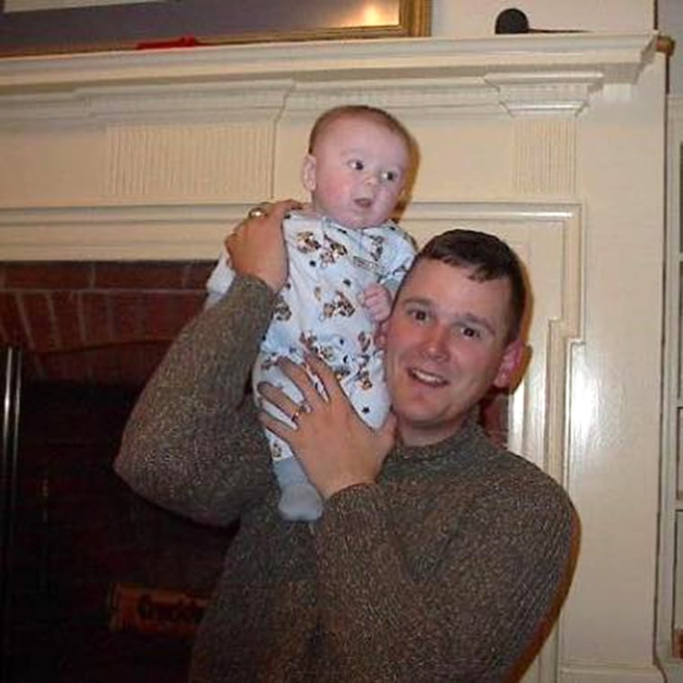 Image: Soldier Holds Son