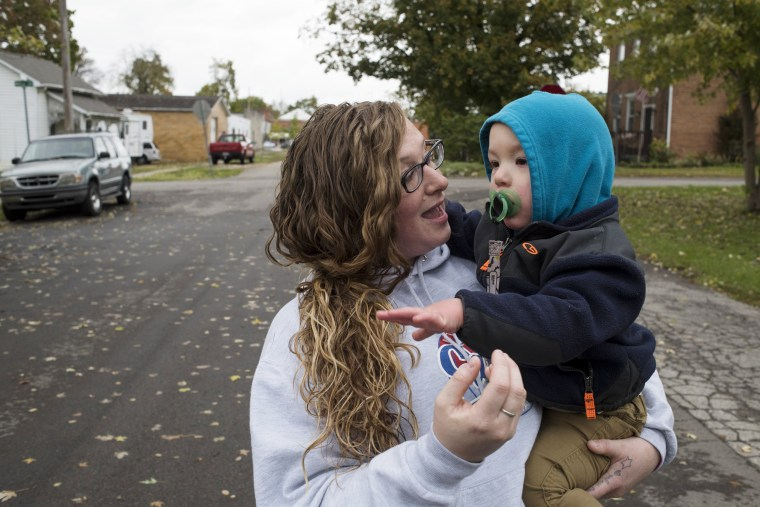 Image: Erika Hurt holds her son