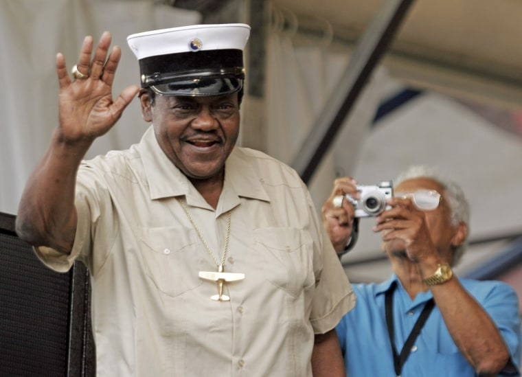 Fats Domino tips his hat to the crowd during the New Orleans Jazz and Heritage Festival
