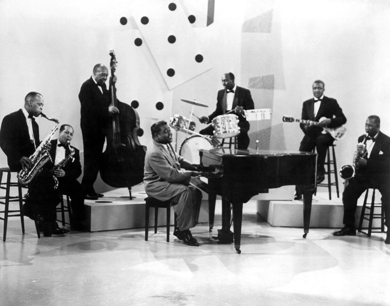 Fats Domino performs with his band in 1957.
