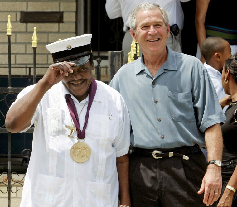 Image: FILE PHOTO -  US President Bush meets with musician Fats Domino in New Orleans