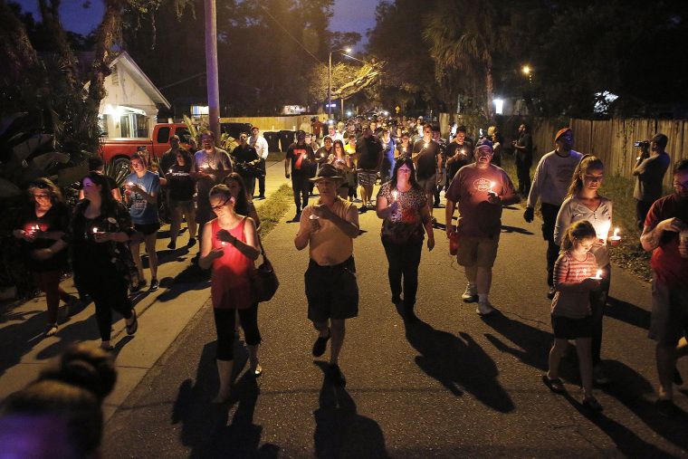Image: A peaceful march that began on east New Orleans Avenue was held during a candlelight vigil