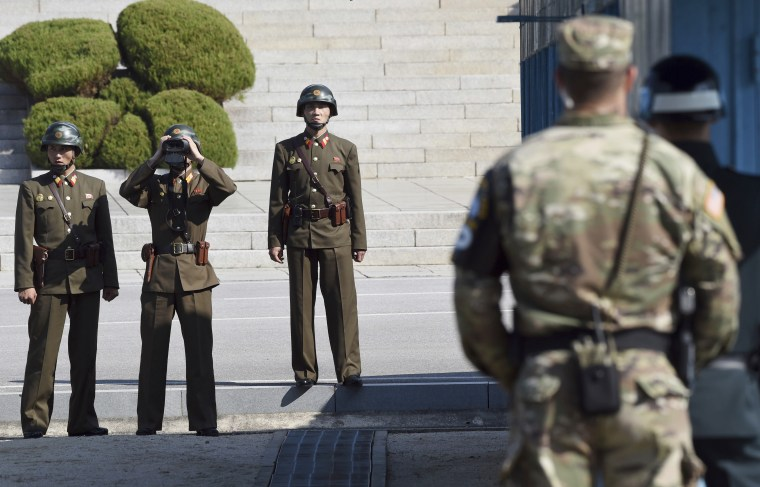 North Korean soldiers, left, look at the South side while U.S. Defense Secretary Jim Mattis visits the truce village of Panmunjom in the Demilitarized Zone on Friday.