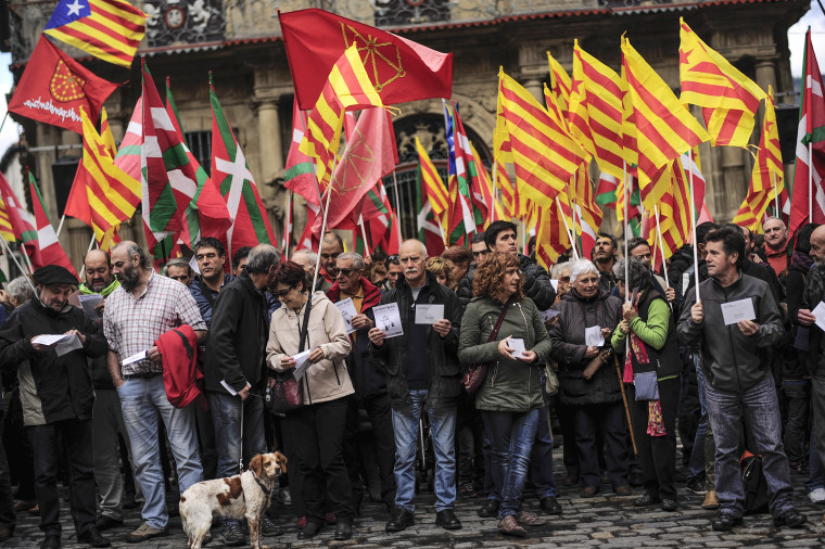 Image: Pro-independence demonstrators of Catalonia and Basque Country raise their regional flags