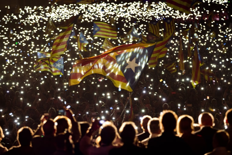 """Pro-independence supporters wave """"estelada"""" or pro independence flags during a rally of """"Junts pel Si"""" or """"Together for YES"""" in Barcelona, Spain on Sept. 25, 2015."""