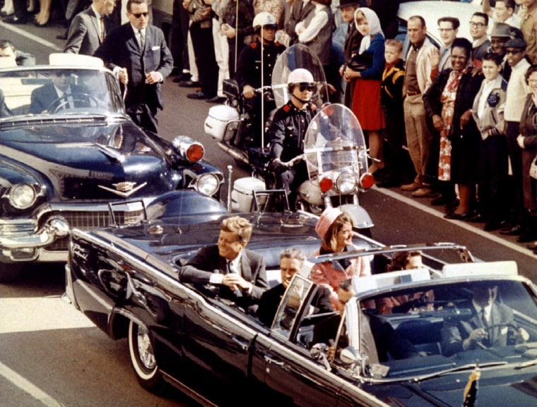 Image: President John F. Kennedy, First Lady Jaqueline Kennedy and Texas Governor John Connally ride  in a liousine moments before Kennedy was assassinated, in Dallas